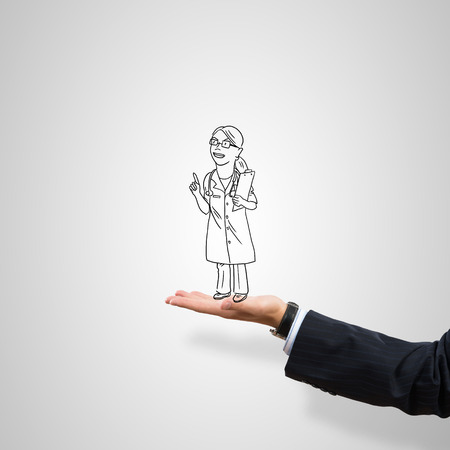 male palm: Drawn woman doctor in male palm on gray background