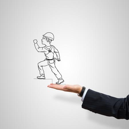 ingeniero caricatura: Hombre construcci�n Dibujado en la palma masculina sobre fondo gris
