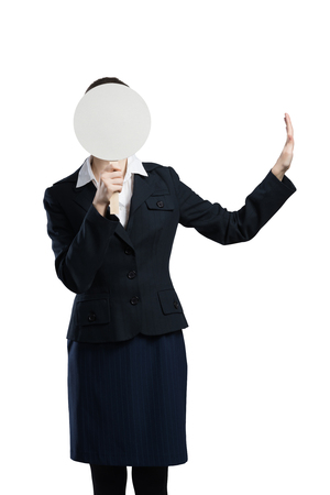 hidden success: Businesswoman hiding her face behind round banner with smiley