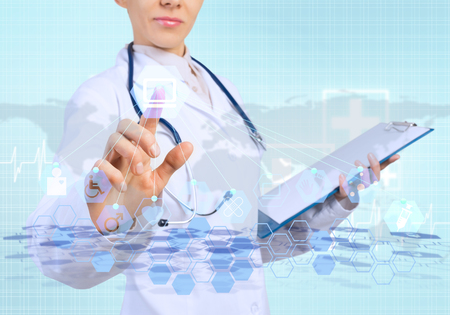 technology: Young female doctor touching icon of media screen
