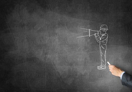 ingeniero caricatura: Male hand drawing with chalk engineer man on blackboard Foto de archivo
