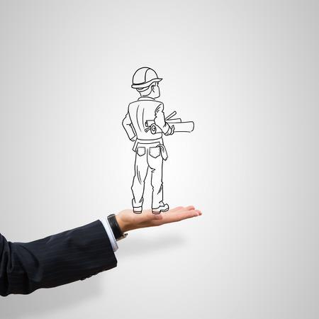 ingeniero caricatura: Hombre construcción Dibujado en la palma masculina sobre fondo gris