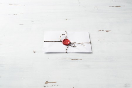 old envelope: Old letter envelope with wax seal on wooden surface