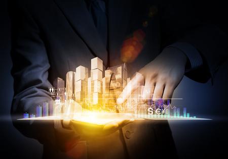 Close up of businessman holding virtual graph in palm Zdjęcie Seryjne