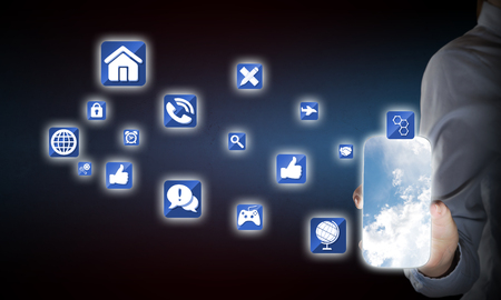 smartphone apps: Hand holding smartphone and apps icons flying in air