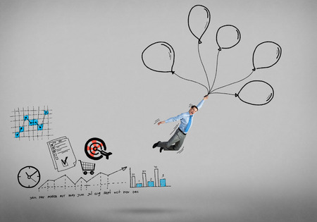 success man: Young successful businessman flying on bunch of drawn balloons Stock Photo