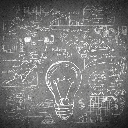 cement solution: Conceptual sketched image of light bulb and ideas on concrete wall