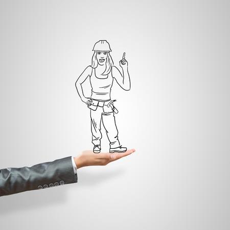 ingeniero caricatura: Empresaria Dibujado en la palma femenina sobre fondo gris Foto de archivo