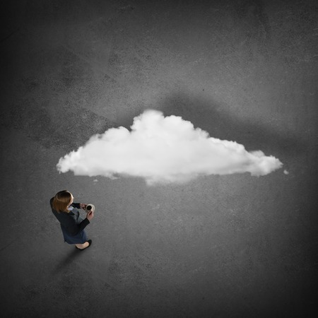 dudando: Top view of thoughtful businesswoman looking at cloud concept on floor Foto de archivo