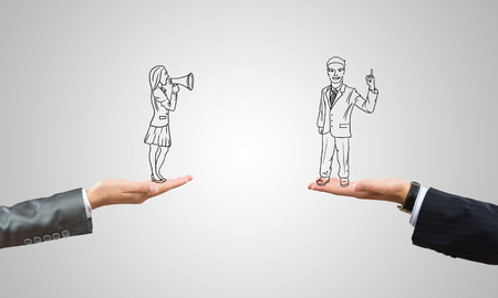 ingeniero caricatura: Drawn businesspeople in human palms on gray background Foto de archivo