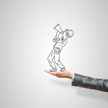ingeniero caricatura: Empresario Dibujado en la palma femenina sobre fondo gris Foto de archivo