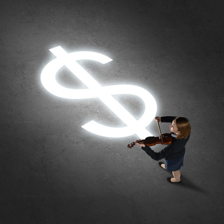 Top view of businesswoman playing violin and glowing sign on concrete floor