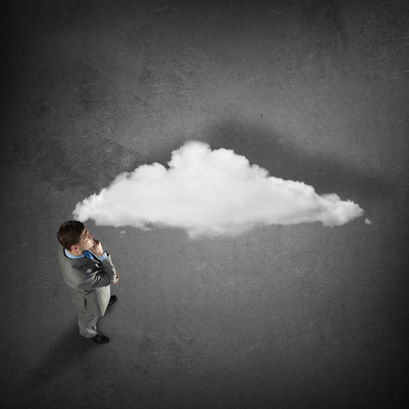 thought cloud: Top view of thinking businessman and white thought cloud Stock Photo