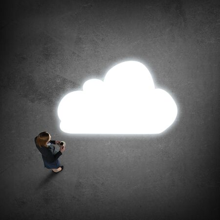hesitating: Top view of thoughtful businesswoman looking at cloud concept on floor Stock Photo