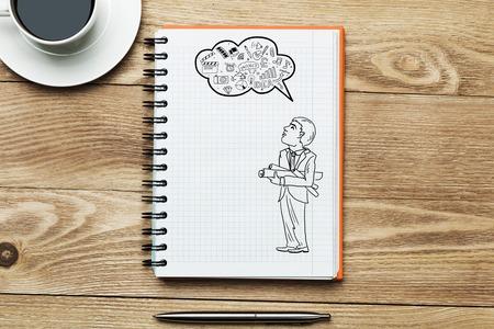 ingeniero caricatura: Bloc de notas con el ingeniero de sexo masculino esboza la taza de caf� y l�piz sobre la mesa de madera
