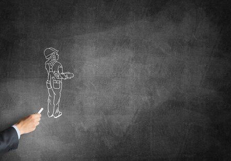 ingeniero caricatura: Male hand drawing with chalk engineer woman on blackboard
