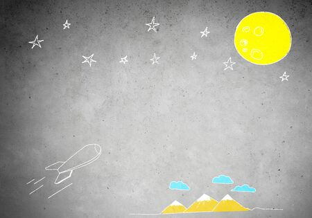 quick drawing: Background image with flying drawn rocket on cement wall