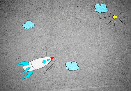 Image de fond avec le vol dessiné roquette sur le mur de ciment