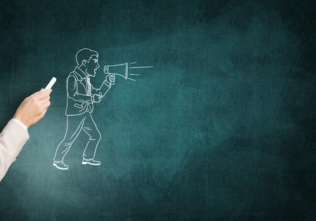 agressive: Female hand drawing with chalk businessman on blackboard
