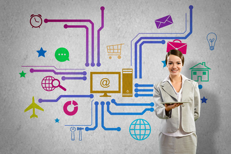 e systems: Businesswoman presenting tablet pc and color icons at background