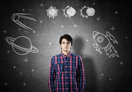 become: Student guy in jacket and glasses dreaming to become astronaut