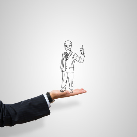 caricature: Drawn businessman in male palm on gray background
