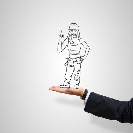 ingeniero caricatura: Mujer ingeniero Dibujado en la palma femenina sobre fondo gris