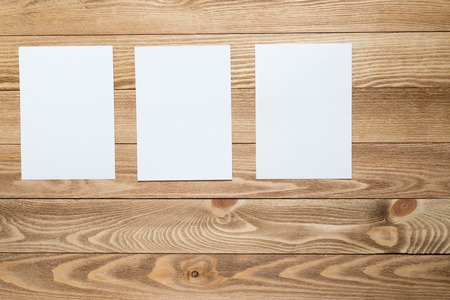 blank photo: Blank paper sheets for text hanging on rope