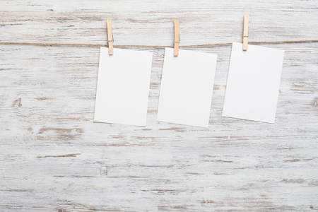 copy paste: Blank paper sheet for text hanging on rope Stock Photo