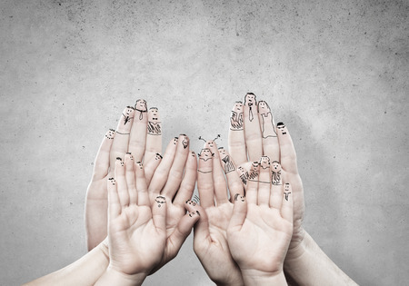 smilie: Close view of child and parent hands as symbol of happy family