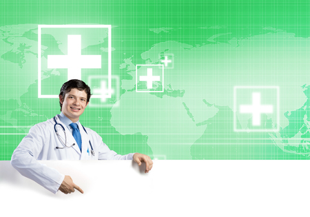 druggist: Young handsome doctor holding white blank banner. Stock Photo