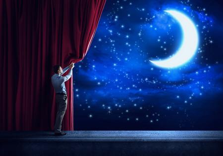 夜街背景カーテンとの場面に立って実業家 写真素材
