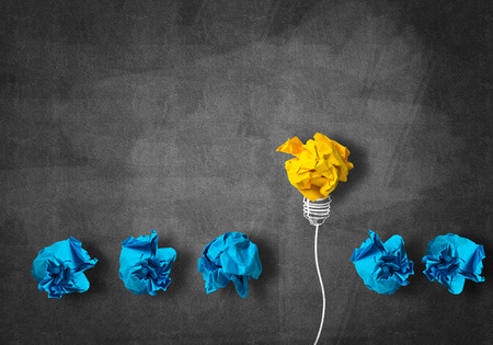 creativity concept: Inspiration concept with crumpled paper light bulb as good idea