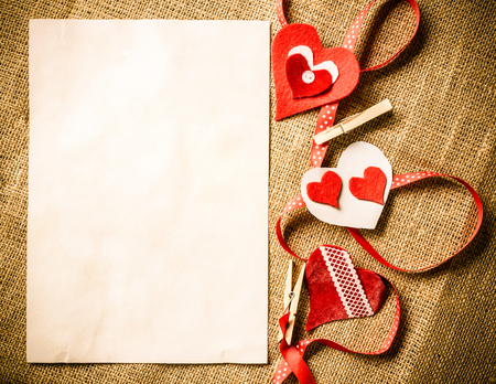 paper sheets: Handmade love hearts and sheets of blank paper Stock Photo