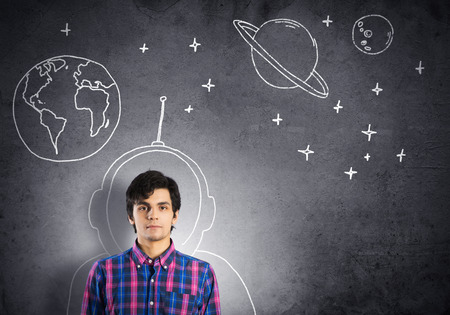 Student guy in jacket and glasses dreaming to become astronaut