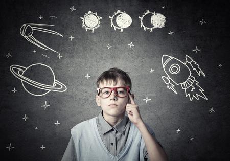 fantasizing: Cute boy of school age dreaming he is astronaut