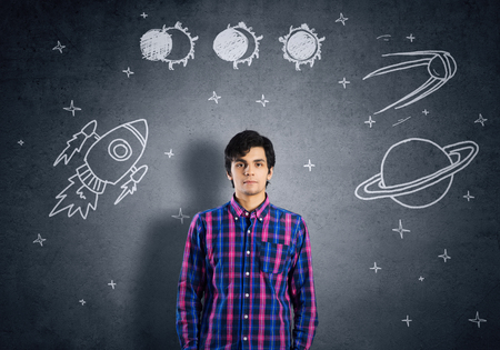 univercity: Student guy in jacket and glasses dreaming to become astronaut