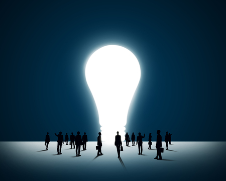 large group of business people: Large group of business people and big light bulb