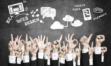 many hands: Many hands of businesspeople showing different gestures Stock Photo