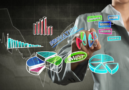 economic forecast: Close view of businesswoman drawing colorful diagrams and graphs on screen Stock Photo