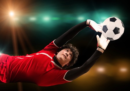 arquero de futbol: Portrait of goalkeeper in jump catching ball