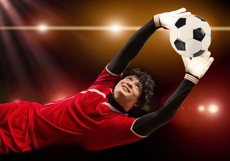 arquero de futbol: Portrait of goalkeeper in jump catching ball