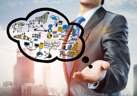 advise: Close up of businessman hand showing cloud with business sketches Stock Photo