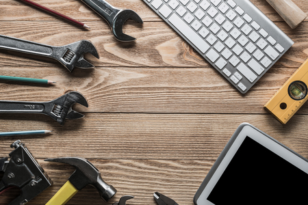 erector: Variety of tools of builder and tablet pc on wooden texture table