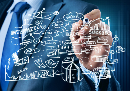 economic forecast: Close view of businessman drawing strategy plan on screen Stock Photo