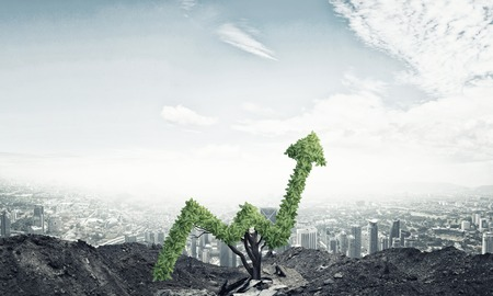 smart investing: Market growth and success as growing green tree in shape of arrow