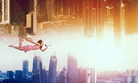 weightless: Young woman flying between two reality worlds Stock Photo