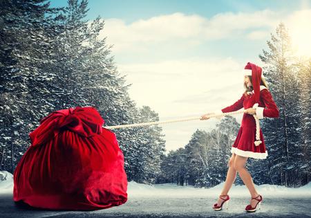 express positivity: Santa woman pulling huge red gifts bag