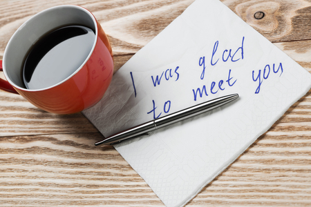 love confession: Coffee cup pen and napkin with words on wooden table