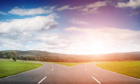 Natural landscape image of forked asphalt road Stock Photo